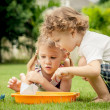 Two happy little kids playing in the garden — Stock Photo #36965283