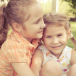 Two happy little girls playing in park in day time — Stock Photo #36965645