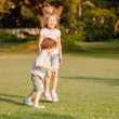 Two happy little kids playing in park in day time — Stock Photo #36967967