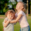 Two happy little kids playing in the park in the day time — Stock Photo