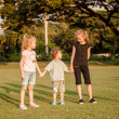 Three happy little kids playing in park in day time — Stock Photo #36968575