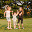 Three happy little kids playing in the park in the day time — Stock Photo