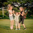Three happy little kids playing in park in day time — Stock Photo #36968757