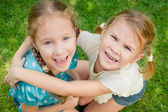 Two happy little girls in the park — Stock Photo