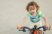 Happy child on a bicycle — Stok fotoğraf