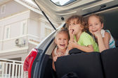 Three happy kids in the car — Stock Photo