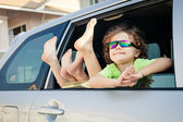 Happy little  boy sitting in the car — Stock Photo
