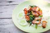Fried crispy barbecue pork with basil leaves and chilly and egg  — Stock Photo