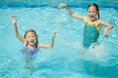 Two little kids playing in the pool — Stock Photo