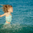 Flying jumping beach girl at blue sea shore in summer vacation i — Stock Photo
