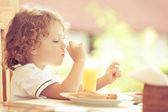 Little boy at breakfast — Stock Photo