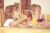 Brother and sister at breakfast — Stock Photo
