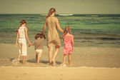 Happy family walking on the beach at the day time — Stock Photo