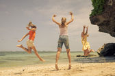 Happy family playing on the beach at the day time — Stockfoto