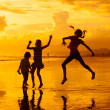 Happy children playing at the beach on the dawn time — Stock Photo #48538537