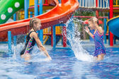 Two little kids playing in the swimming pool — Stok fotoğraf