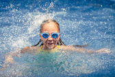 Teen happy girl playing in the swimming pool — Stok fotoğraf