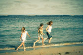 Happy family walking at the beach at the day time — Stok fotoğraf
