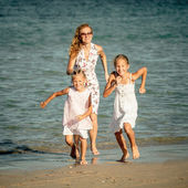 Happy family running at the beach at the day time — Stock Photo