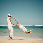 Father and daughter playing on the beach at the day time — Stock Photo