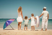 Happy family playing on the beach at the day time — Stock Photo