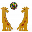 Royalty-Free Stock Photo: Giraffes Playing with Jigsaw Puzzle Ball