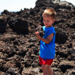 Child holding piece of set lava — Stock Photo #12032904