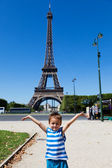Child under Eiffel tower — Stock Photo