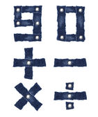 9, 0 and mathematic symbol from jeans fabric — Stock Photo