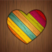 Vector colorful wooden heart on wooden background. Eps10 — Stock Vector