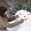Happy middle age woman and snowman — Foto Stock