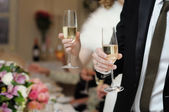 With champagne glasses — Stock Photo