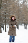 Happy middle age woman holding snowball — Stock Photo