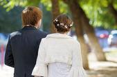 Bride and groom walking — Stock Photo