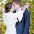Stock Photo: Beautiful bride and groom kissing