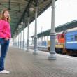 Girl on railway station platform — Stock Photo