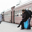 Couple on railway station platform - Stock Photo