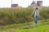Girl walking outdoor — Stock Photo