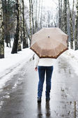 Woman at rainy and snowy day — Stock Photo