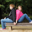 Stock Photo: Couple sitting on bench