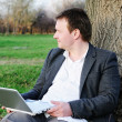 Middle age man with laptop outdoors — 图库照片