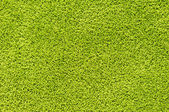 Green carpet texture — Stock fotografie