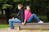Couple sitting on the bench — Stock Photo