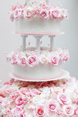 Delicious wedding cake decorated with roses — Stock Photo