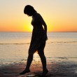 Woman as silhouette by the sea — Stock Photo #23503209