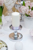 White candle with silk ribbon — Stock Photo