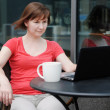 Royalty-Free Stock Photo: Woman using laptop in a outdoor cafe