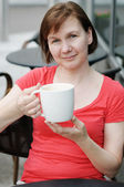 Woman in a outdoor cafe — Stock Photo