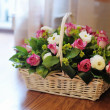 Bouquet of flowers in basket — Stock Photo