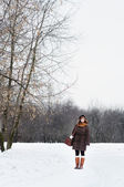 Woman walking in winter park — 图库照片